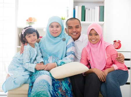 south asians: indonesian malay family having a good time
