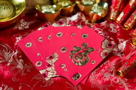 pow: ang pow , chinese new year items with plenty of chinse new year decorations