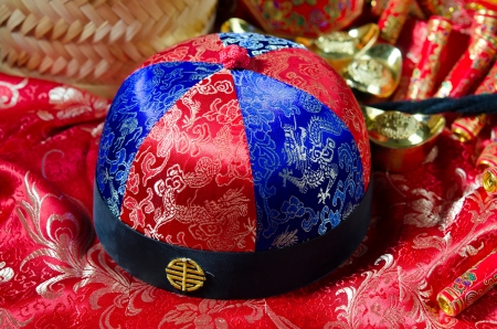 chinese hat: chinese new year hat with decorations on the background Stock Photo