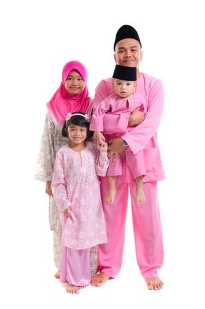 hari raya: malay family during hari raya isolated on white Stock Photo