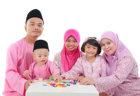 salam: malay family playing and having quality time during hari raya