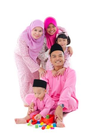 hari raya: indonesian family having fun during hari raya