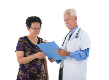 chinese senior doctor with patient photo