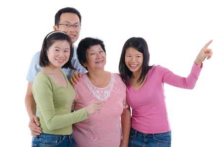 happy adult asian family pointing somewhere photo