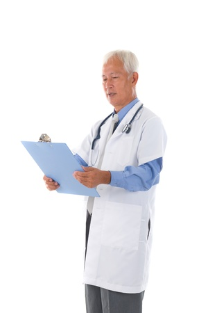 chinese senior doctor reading medical report photo