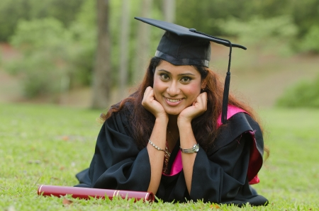 indian female graduate with green background photo