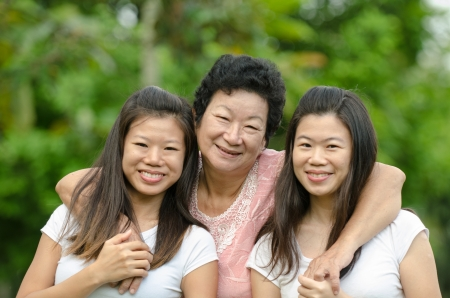 chinese daughter and mother on green outdoor Stock Photo - 18127757