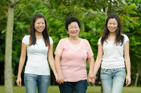 chinese daughter and mother on green outdoor Stock Photo - 18127752