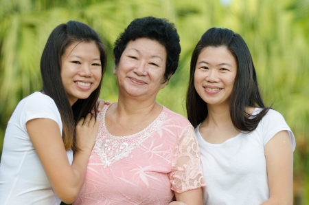 chinese daughter and mother on green outdoor photo
