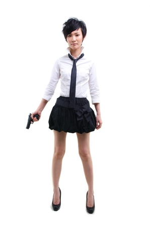 tomboy: korean girl with a hand gun Stock Photo