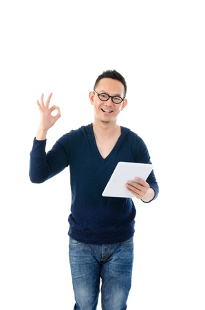 asian teacher: young asian male with a generic tablet. standing with casual jeans and isolated with white background   Stock Photo