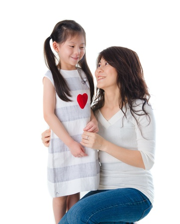 korean mother and her daughter with isolated background during mothers day photo