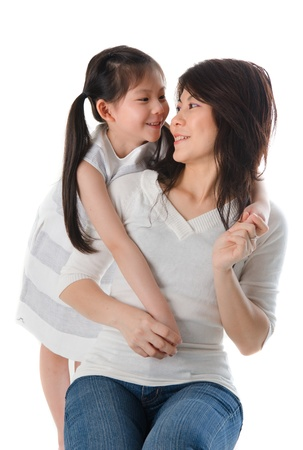 2 years old: korean mother and her daughter with isolated background
