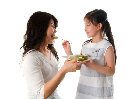 asian chinese daughter feeding her mother, bonding photo