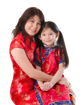 Chinese mother and daughter in traditional china dress isolated on white background photo