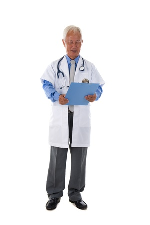 taiwanese: taiwanese senior doctor holding a folder with isolated white background Stock Photo