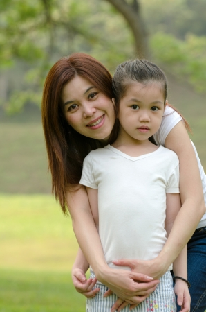 asian chinese mother and  daughter in the park photo