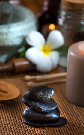 hot stone massage with spa treatment items on the background photo
