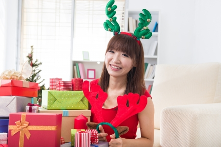 asian girl christmas celebration at her home Stock Photo - 18573769
