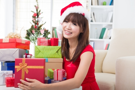 asian girl christmas celebration at her home photo