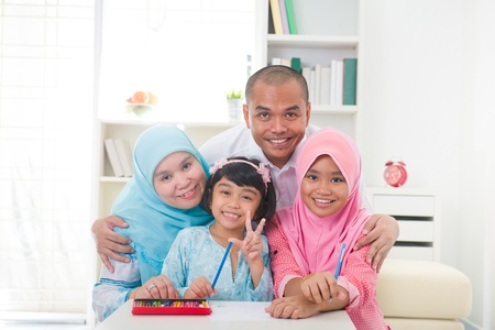 family time: malaysian malay muslim family learning together with lifestyle background
