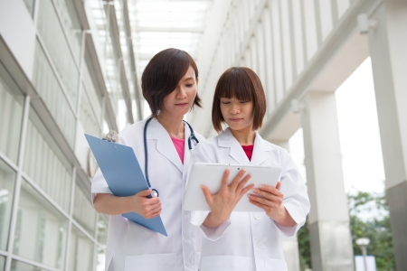 asian nurse: asian medical chinese doctors looking at somewhere
