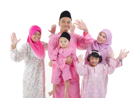 malay family enjoying quality time together with traditonal clothes photo