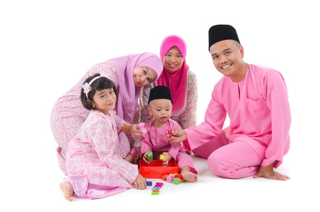 indonesian woman: indonesian family having fun during hari raya     Stock Photo