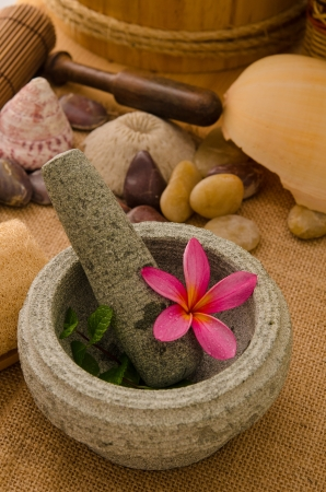 tropical spa setup with traditional frangipani flower and massage items