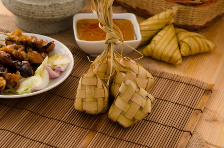 compressed rice: Ketupat  South East Asian rice cakes bundle, often prepared for festivities and celebratory occasions