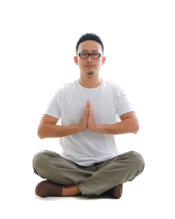 chinese male performing yoga with white background Stock Photo - 18843770