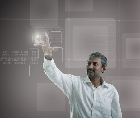 computer software: asian indian businessman  pressing high tech type of modern buttons on a virtual background