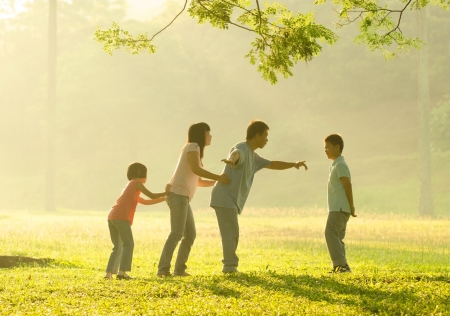 asian family outdoor:  happy asian family playing having quality time at outdoor green  park