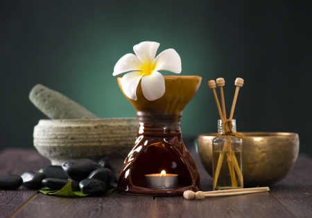 tropical frangipani spa health treatment with aroma therapy and hot stones, shot with ambient lights Stock Photo