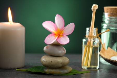 seething: tropical frangipani spa health treatment with aroma therapy and hot stones, shot with ambient lights Stock Photo