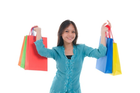 pan asian: happy young malay girl during shopping festival with white background Stock Photo