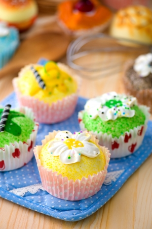 cup cakes with a lot of bread pastry background Stock Photo - 19384020