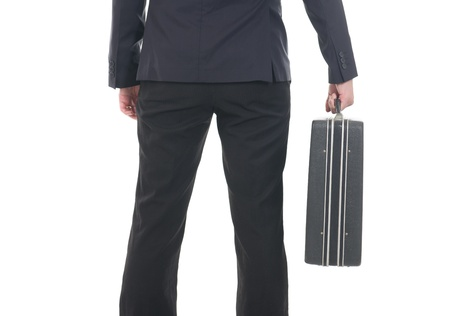 Business suitcase behing held by a man  isolated on white background , focus on the suitcase   photo