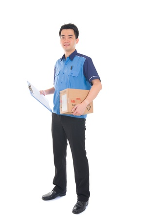 dispatch: asian delivery dispatch boy delivering a package isolated against white background   Stock Photo
