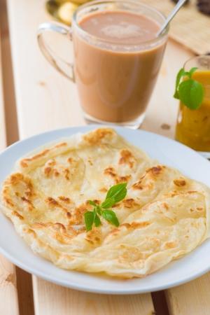 tarik: roti canai and teh tarik, very famous drink and food in malaysia