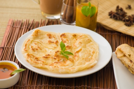 malaysian food: roti canai and teh tarik, very famous drink and food in malaysia