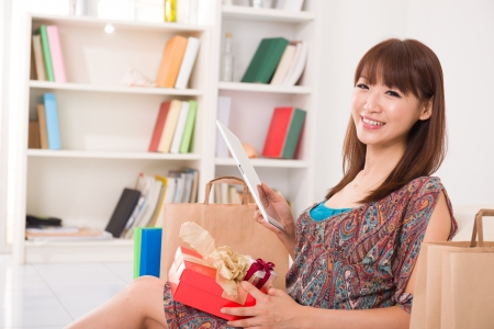 asian Chinese female online shopping with lifestyle background   photo