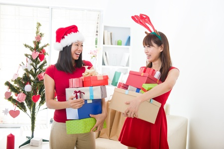 party room: chinese girl friends during a christmas celebration   Stock Photo