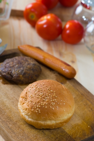 making hamburger fast food ingredients with plenty of raw materials on the background   photo