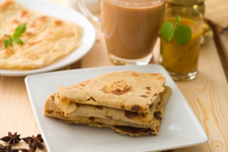 puri: Chapati stacked, Indian flat bread in plate usually served with curry. Popular foods in Malaysia