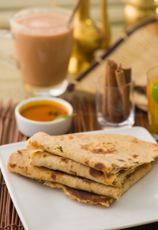 Chapati , Indian flat bread in plate usually served with curry  photo