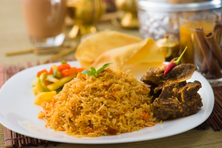biryani: Biryani mutton rice papadam with traditional background Stock Photo