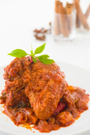 curry chicken, indian cuisine with traditional food items on background   photo