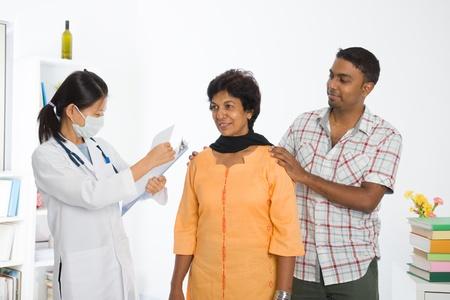 indian punjabi senior medical checkup with an asian female doctor   photo