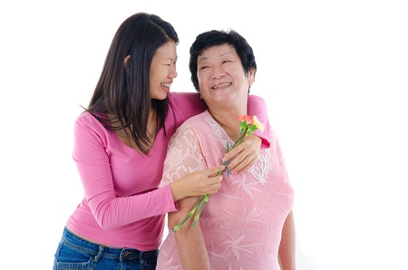 Happy Asian Chinese Mother and Daughter with carnation flower with isolated white background   photo
